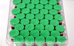 Green medicine opener Royalty Free Stock Photos