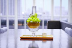 Green melon ball shape are arranged on the top of bingsu (korean ice-cream style) and decorated with green tea ice-cream and mint. Leaf on the wood plate and royalty free stock images