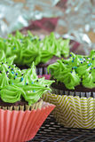 Green and melon cupcakes. Chocolate cupcakes with green frosting and sprinkles Stock Photography