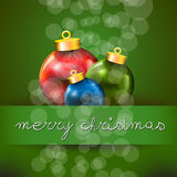 Green Merry Christmas Card with Three Colored Xmas. Green Merry Xmas card with the Christmas ball Icons, and copyspace with an hand written wish text Stock Photos