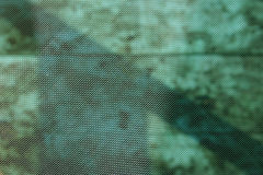 Green mesh. Mesh with blured green background Royalty Free Stock Photo