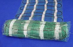 Green mesh pack on blue carpet, Stock Photography