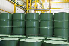 Green metal barrels Stock Images