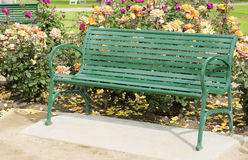 Green metal bench in the Park. Royalty Free Stock Images