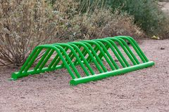 Green metal bicycle rack in the rock royalty free stock photography