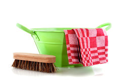 Green metal bucket with cleaning brush Royalty Free Stock Images