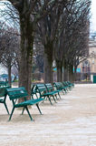 Green metal chairs in the garden in winter season Royalty Free Stock Image