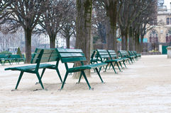 Green metal chairs in the garden in winter season Stock Image