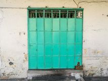 Green metal collapsible vintage door in Penang Malaysia. Green metal collapsible vintage door in Penang city in Malaysia Royalty Free Stock Photo