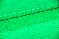 Green metal diamond floor plate light and shadow texture background royalty free stock photography