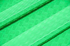Green metal diamond floor plate light and shadow texture background royalty free stock images