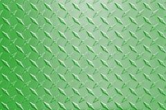 Green metal diamond plate pattern background. Stock Photos