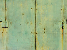 Green metal door detail. A background texture of a weathered green metal door royalty free stock image