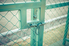 Green metal fence lock with pastel tone. Photo Green metal fence lock with pastel tone Stock Photos