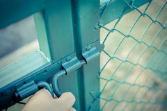 Green metal fence lock with pastel tone. Photo Green metal fence lock with pastel tone Stock Images
