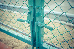 Green metal fence lock with pastel tone. Photo Green metal fence lock with pastel tone Royalty Free Stock Image