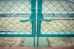 Green metal fence lock with pastel tone. Photo Green metal fence lock with pastel tone Royalty Free Stock Images