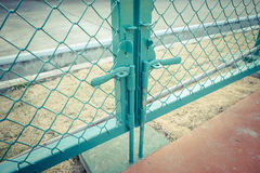 Green metal fence lock with pastel tone. Photo Green metal fence lock with pastel tone Stock Photo