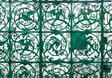 Green metal fence with mythical creatures, Nizhny Novgorod, Russia. Green metal fence with image of mythical creatures, Nizhny Novgorod, Russia Stock Photos