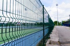 Green Metal fence wire Stock Image