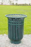 Green metal garbage bin box in park Stock Photos