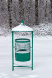 Green metal garbage bin in park at winter Stock Images