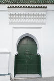 Green metal gate of ancient mosque in Medina Stock Image