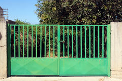 Green metal gate Stock Photography