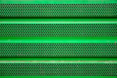 Green metal grill background, iron coating stock image