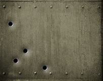 Green metal plate with bullet holes 3d illustration Royalty Free Stock Photos
