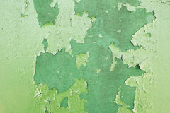 Green metal plate with cracked paint and big paint spots because Stock Image