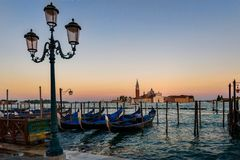 Green Metal Post in Front of the Body of Ocean With Boats during Twilight Royalty Free Stock Image