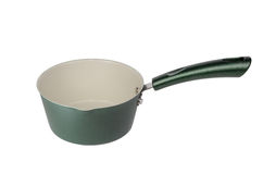 Green metal pot with a long handle. Stock Photos