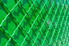 Green metal reconditioned fence Stock Images