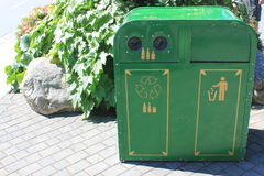 Green metal recycling and trash bin Stock Images