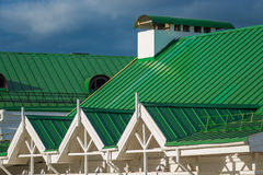 Green metal roof of structures Stock Photos