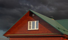 Green metal roof under dark cloudy sky Royalty Free Stock Photo