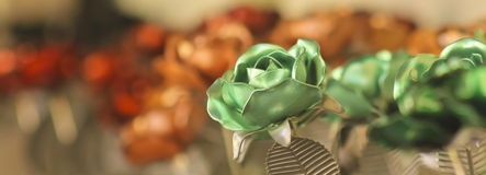 A Green Metal Rose Among Dozens More Stock Image