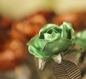 A Green Metal Rose Among Dozens More Stock Photos