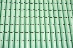 Green metal tile house roof as texture Stock Photos