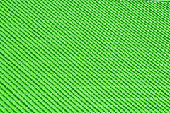 Green metal tiles on a roof Stock Photography