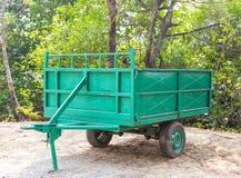 Green metal trailer of large garbage bin Stock Image