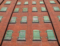 Green metal windows on brick wall. Stock Photography