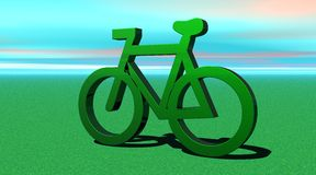 Green metallic bicycle on the grass Stock Photo