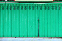 Green metallic door Stock Images