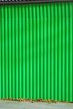 Green metallic fence. Stock Photo