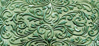 Green metallic floral pattern. Abstract background with green metallic floral texture Stock Photo