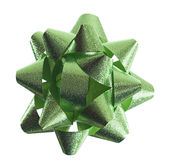 Green metallic gift ribbon rosette. Pale green textured iridescent ribbon rosette isolated on white stock photography