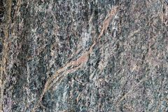 Green metamorphic layered rock surface used as a decorative material Stock Photos