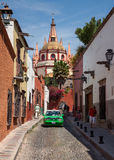 Green Mexican Taxi in Front of Parish Cathedral in San Miguel de Allende of Mexico Stock Photo